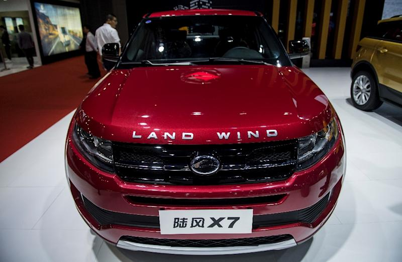 Land Rover's Range Rover Evoque SUV is on display at Shanghai's auto show, as is a model by similarly-named Chinese carmaker Landwind that has sparked a legal battle between the two (AFP Photo/Johannes EISELE)