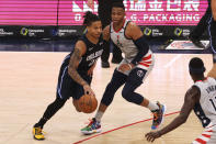 Orlando Magic guard Markelle Fultz (20) drives to the basket past Washington Wizards guard Russell Westbrook (4) in the third quarter of an NBA basketball game Saturday, Dec. 26, 2020, in Washington. (Geoff Burke/Pool Photo via AP)