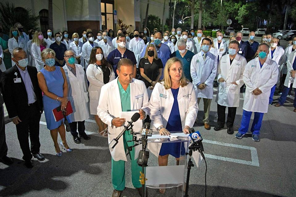 Dr. Rupesh Dharia and Dr. Jennifer Buczyner speak out as a group of physicians and administrators gathered in Palm Beach Gardens early Monday morning, August 23, 2021 to support vaccinations and the wearing of masks in their fight against COVID-19.