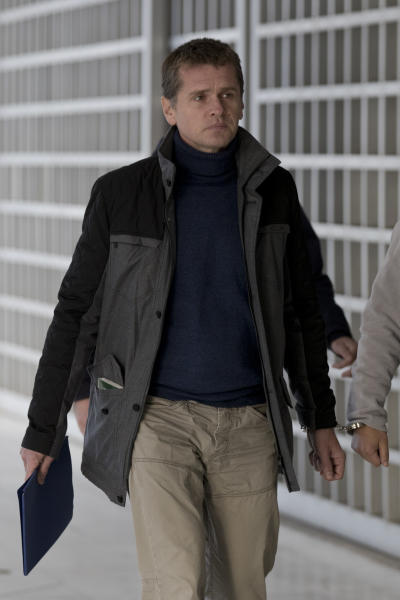 In this Wednesday, Dec. 6, 2017 file photo, Russian cybercrime suspect Alexander Vinnik, arrives at Greece's supreme court in Athens. Greece's justice minister has signed an order on Friday, Dec. 20, 2019, for bitcoin fraud suspect Alexander Vinnik to be extradited to France - concluding an international legal battle surrounding the Russian former cryptocurrency trading platform operator. (AP Photo/Petros Giannakouris, file)