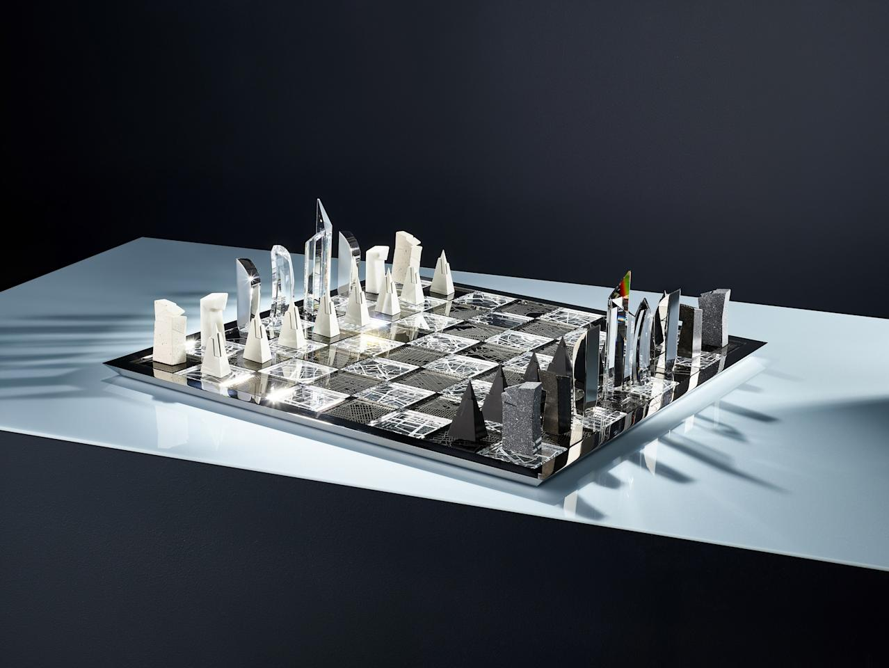 "Architect Daniel Liebeskind's <a href=""https://www.atelierswarovski.com/architecture-the-city-chess-set-monochrome"">Architecture & the City</a> chess set for Atelier Swarovski reinterprets the skylines of New York and Milan. Liebeskind mixed a number of materials, including concrete, marble, aluminum, silver, and Swarovski crystal, for the $18,000 set."