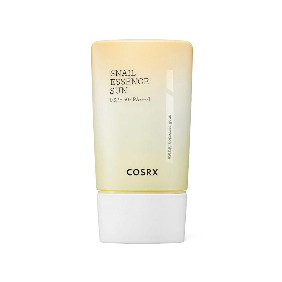 """Cosrx's Shield Fit Snail Essence Sun SPF 50+ combines two major elements of K-beauty: <a href=""""https://www.allure.com/gallery/best-korean-sunscreen?mbid=synd_yahoo_rss"""" rel=""""nofollow noopener"""" target=""""_blank"""" data-ylk=""""slk:sun protection"""" class=""""link rapid-noclick-resp"""">sun protection</a> and <a href=""""https://www.allure.com/story/hyperpigmentation-treatment-snail-mucin-review-before-after-photos?mbid=synd_yahoo_rss"""" rel=""""nofollow noopener"""" target=""""_blank"""" data-ylk=""""slk:snail mucin"""" class=""""link rapid-noclick-resp"""">snail mucin</a>. This milky formula goes on <em>and</em> dries down totally clear while amping up your natural glow, to boot. Calming ingredients like <a href=""""https://www.allure.com/story/what-is-allantoin-skin-care-ingredient-korean-beauty?mbid=synd_yahoo_rss"""" rel=""""nofollow noopener"""" target=""""_blank"""" data-ylk=""""slk:allantoin"""" class=""""link rapid-noclick-resp"""">allantoin</a> and bergamot oil soothe any irritation and breakouts you're experiencing without leaving behind any heavy or greasy residue. <em>Allure</em> editors Devon Abelman and Sarah Han swear by this fast-absorbing wonder, no matter what their skin condition — it's just that dependable."""