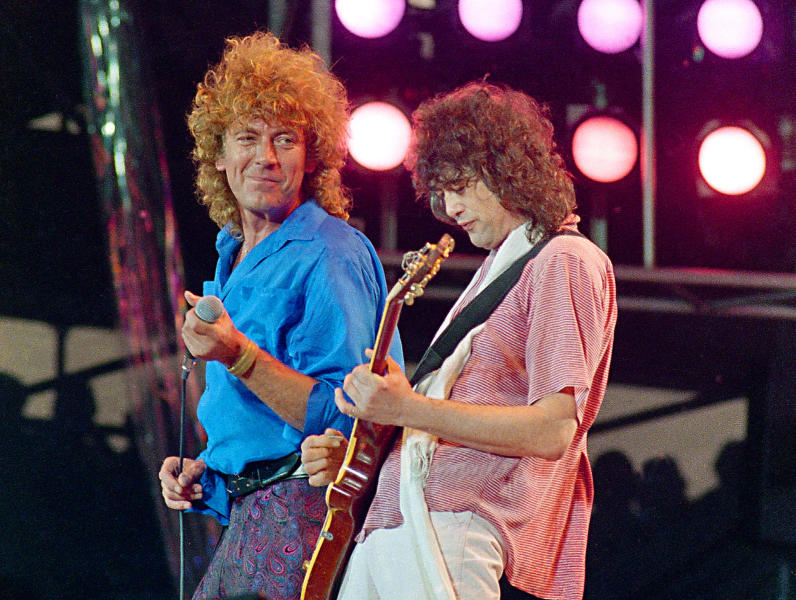 "FILE - In this July 13, 1985 file photo, Led Zeppelin bandmates, singer Robert Plant, left, and guitarist Jimmy Page, reunite to perform for the Live Aid famine relief concert at JFK Stadium in Philadelphia. From left are John Bonham, Robert Plant, Denny and Jimmy Page. A federal appeals court on Monday, March 9, 2020, restored a jury verdict that found Led Zeppelin did not steal ""Stairway to Heaven."" (AP Photo/Amy Sancetta, File)"