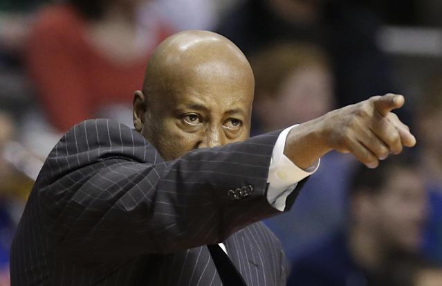 New York Knicks head coach Mike Woodson points during the second half of an NBA basketball game against the Detroit Pistons in Auburn Hills, Mich., Monday, March 3, 2014. (AP Photo/Carlos Osorio)