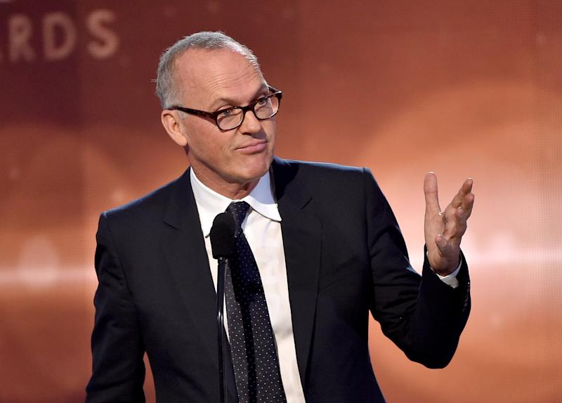 Michael Keaton accepts the Career Achievement Award onstage during the 18th Annual Hollywood Film Awards at The Palladium on November 14, 2014 in Hollywood, California (AFP Photo/Kevin Winter)