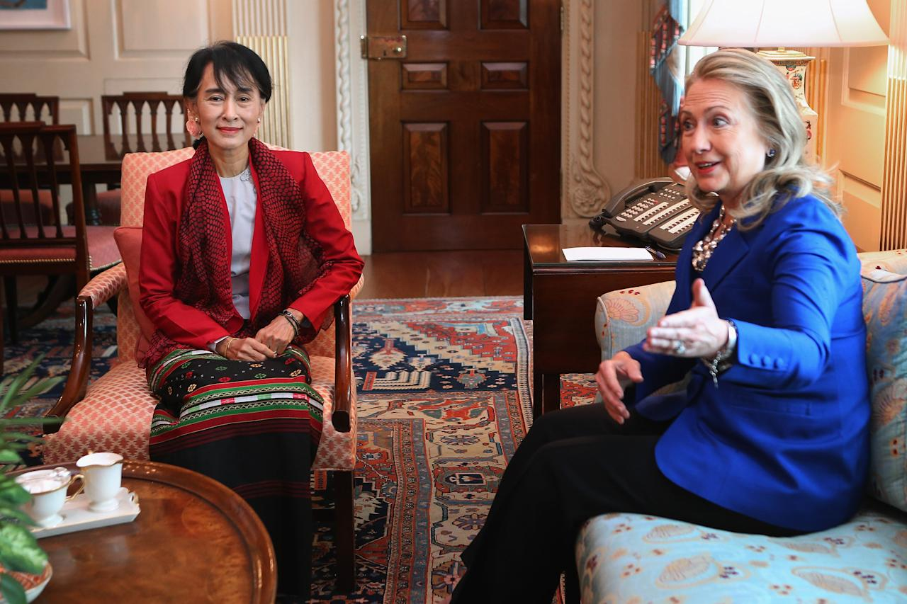 U.S. Secretary of State Hillary Clinton (R) meets with Nobel Peace Prize winner and Burmese pro-democracy opposition leader Daw Aung San Suu Kyi in Clinton's office at the State Department September 18, 2012 in Washington, DC. Having spend most of the last two decades as a political prisoner under house arrest in her home nation of Myannmar, formerly known as Burma, Suu Kyi was elected to Parliament in 2012 and her political party, the National League for Democracy, won a majority of seats.  (Photo by Chip Somodevilla/Getty Images)