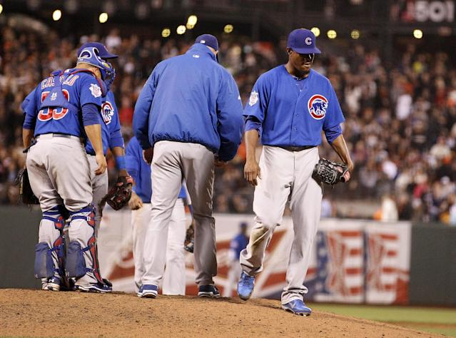 Chicago Cubs starting pitcher Edwin Jackson, right, is taken out of the game by Chicago Cubs manager Dale Sveum during the seventh inning against San Francisco Giants in a baseball game on Friday, July 26, 2013, in San Francisco. (AP Photo/Tony Avelar)