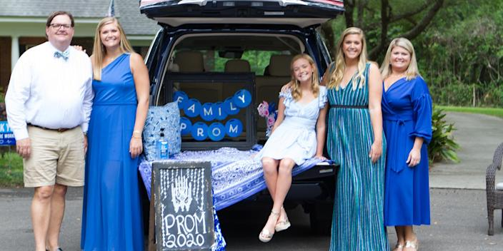 Kaki Kirk, second from the right, poses with her family at her stay-at-home prom in Tallahassee, Florida. (Courtesy of Lea Marshall)