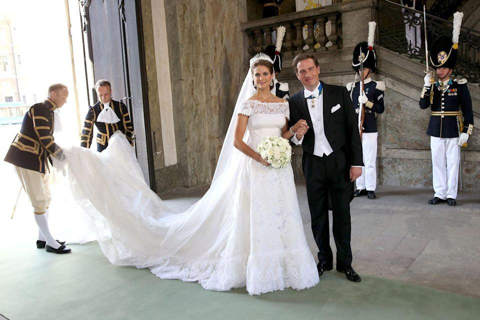 <p>Princess Madeleine and Christopher O'Neill of Sweden were married in Stockholm on June 8, 2013. Designed by Valentino, Princess Madeleine's gown had a wide neckline, short sleeves, a deep-cut back, and an emphasized waist. The dress was made from pleated silk organza with Chantilly lace.</p>