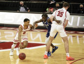 Wisconsin's D'Mitrik Trice (0) drives against Eastern Illinois' Junior Farquhar (5) as Wisconsin's Nate Reuvers (35) sets a screen during the second half of an NCAA college basketball game Wednesday, Nov. 25, 2020, in Madison, Wis. Wisconsin won 77-67. (AP Photo/Andy Manis)