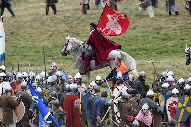 A re-enactor depicting William the Conqueror (C) rides with King Harold's standard after defeating him during a re-enactment of the Battle of Hastings (AFP Photo/Ben Stansall)