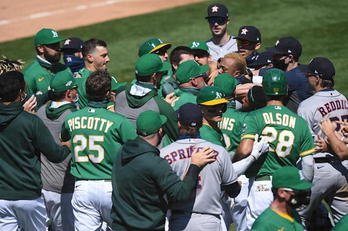 OAKLAND, CA - AUGUST 09: Players and coaches from both sides clash during a benches clearing brawl during the Major League Baseball game between the Houston Astros and the Oakland Athletics on August 9, 2020 at RingCentral Coliseum in Oakland, CA. (Photo by Cody Glenn/Icon Sportswire via Getty Images)