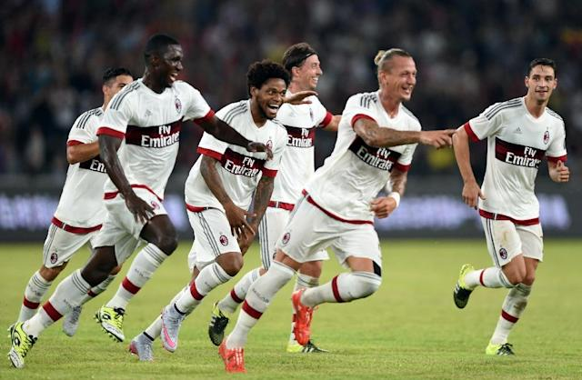 AC Milan players celebrate with defender Philippe Mexes (2nd R) after he scores during the International Champions Cup match against Inter Milan in Shenzhen on July 25, 2015 (AFP Photo/Johannes Eisele)