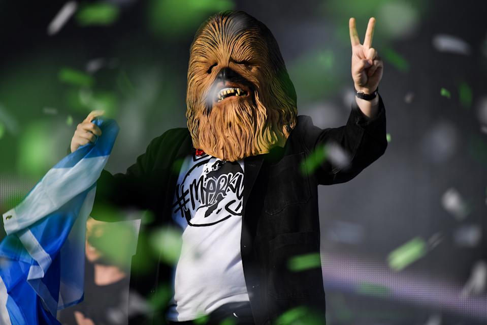 GLASGOW, SCOTLAND - JULY 14: Lewis Capaldi comes on stage wearing a Chewbacca mask to perform on the main stage during the TRNSMT Festival at Glasgow Green on July 14, 2019 in Glasgow, Scotland. A sold out final day will see music fans flock to see performances by Lewis Capaldi , Emeli Sande, The Kooks, The Wombats and Tom Grennan,closing with George Ezra. (Photo by Jeff J Mitchell/Getty Images)