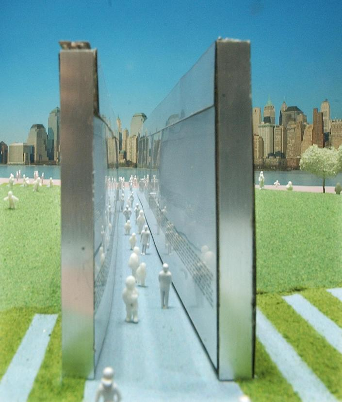"""A model on display at a news conference in Newark, N.J., shows the winning design in the New Jersey September 11th Memorial competition, Wednesday, June 30, 2004. The project, titled """"Empty Sky"""", will be located in Liberty State Park in Jersey City, N.J., and dedicated on September 10, 2011. Looking towards New York, through the projects' two stainless steel walls, which will bear the New Jersey victims' names of the 9/11 attacks, provides a direct view of the location where the World Trade Center stood. (AP Photo/Daniel Hulshizer)"""