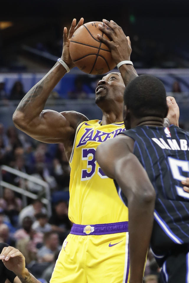 Los Angeles Lakers center Dwight Howard, left, works to get off a shot over Orlando Magic's Mo Bamba, right, during the first half of an NBA basketball game, Wednesday, Dec. 11, 2019, in Orlando, Fla. (AP Photo/John Raoux)