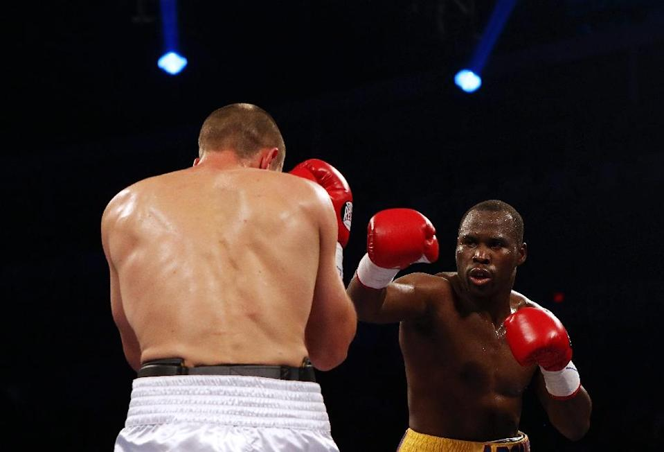 Adonis Stevenson (R) and Tommy Karpency trade punches during their Premier Boxing Champions bout, at the Ricoh Coliseum in Toronto, on September 11, 2015 (AFP Photo/Vaughn Ridley)