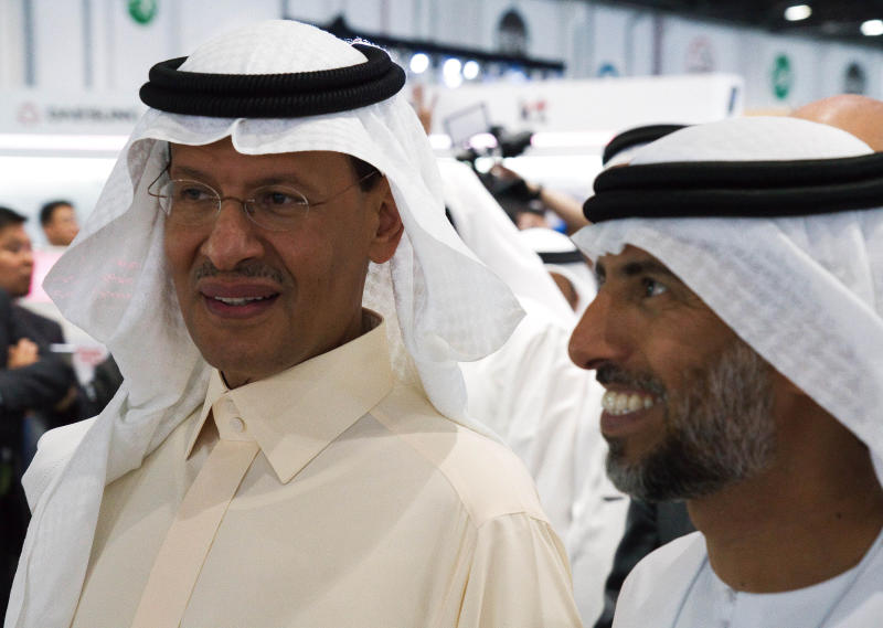 Saudi Arabia's new Energy Minister Prince Abdulaziz bin Salman, left, and United Arab Emirates Energy Minister Suhail al-Mazrouei, right, walk through an energy exhibition in Abu Dhabi, United Arab Emirates, Monday, Sept. 9, 2019. Prince Abdulaziz, as well as the CEOs of Total SA and ENI SpA, were in Abu Dhabi on Monday at the World Energy Congress. (AP Photo/Jon Gambrell)