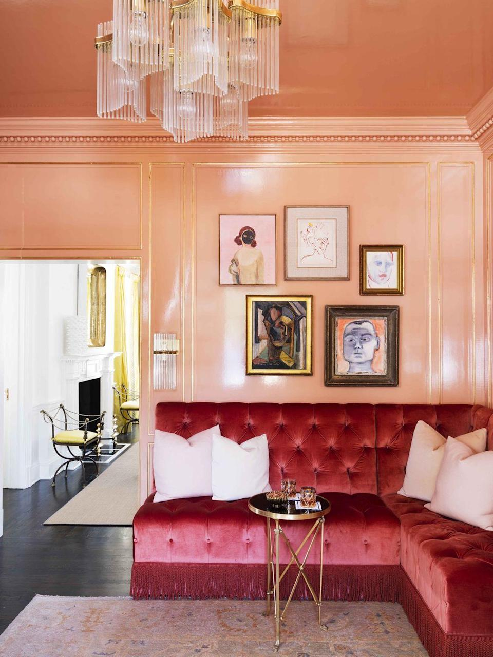 """<p>With walls and a ceiling cloaked in a saturated orange-pink (<a href=""""https://www.farrow-ball.com/"""" rel=""""nofollow noopener"""" target=""""_blank"""" data-ylk=""""slk:Farrow & Ball's"""" class=""""link rapid-noclick-resp"""">Farrow & Ball's</a> Fowler Pink), the ladies' lounge in an Atlanta home by designer <a href=""""http://www.melanieturnerinteriors.com/"""" rel=""""nofollow noopener"""" target=""""_blank"""" data-ylk=""""slk:Melanie Turner"""" class=""""link rapid-noclick-resp"""">Melanie Turner</a> is the epitome of glamour. The custom banquette is covered in a sumptuous <a href=""""https://www.pierrefrey.com/en/"""" rel=""""nofollow noopener"""" target=""""_blank"""" data-ylk=""""slk:Pierre Frey"""" class=""""link rapid-noclick-resp"""">Pierre Frey</a> velvet.</p>"""