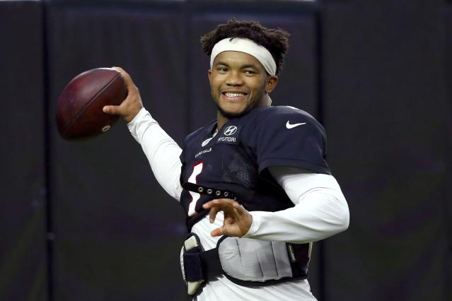 Arizona Cardinals quarterback Kyler Murray smiles as he throws a pass during an NFL football training camp practice at State Farm Stadium Tuesday, Aug. 6, 2019, in Glendale, Ariz. (AP Photo/Ross D. Franklin)