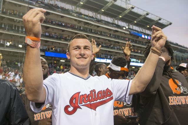 CLEVELAND, OH - JUNE 4: Rookie draft pick Johnny Manziel of the NFL Cleveland Browns acknowledges the crowd prior to the game between the Cleveland Indians and the Boston Red Sox along with other Brows rookies at Progressive Field on June 4, 2014 in Cleveland, Ohio. (Photo by Jason Miller/Getty Images)