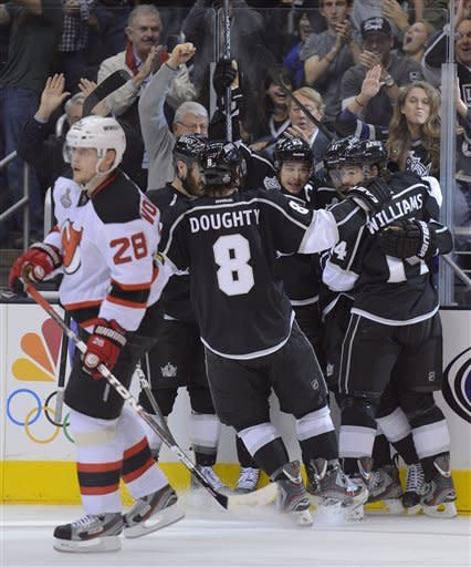The Los Angeles Kings celebrate after scoring a second period goal against the new Jersey Devils during Game 3 of the Stanley Cup Finals, Monday, June 4, 2012, in Los Angeles. Anze Kopitar scored the goal. (AP Photo/Mark J. Terrill)