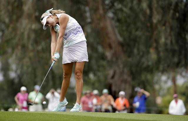 Lexi Thompson hits from the fairway on the ninth hole during the second round of the Kraft Nabisco Championship golf tournament Friday, April 4, 2014, in Rancho Mirage, Calif. (AP Photo/Chris Carlson)