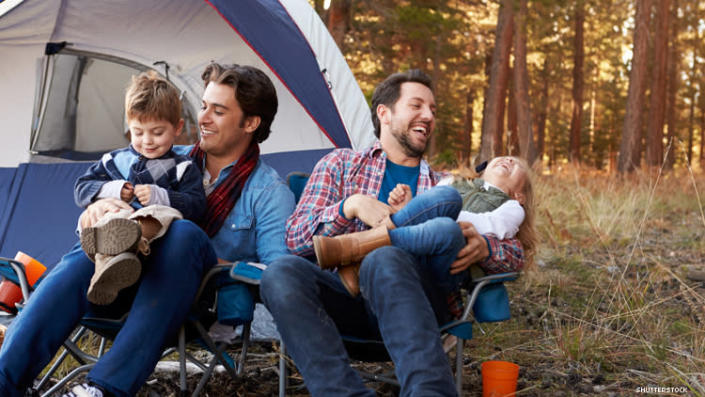 Dads with two kids camping