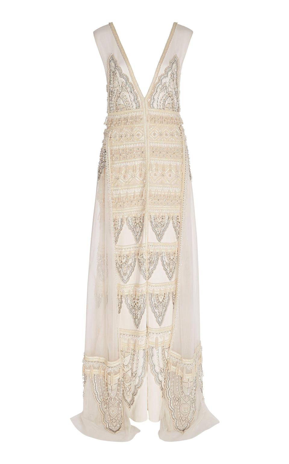 """<p><strong>Cucculelli Shaheen</strong></p><p>modaoperandi.com</p><p><strong>$16800.00</strong></p><p><a href=""""https://go.redirectingat.com?id=74968X1596630&url=https%3A%2F%2Fwww.modaoperandi.com%2Fcucculelli-shaheen-r20%2Fpearl-paisley-embroidered-silk-gown&sref=https%3A%2F%2Fwww.harpersbazaar.com%2Fwedding%2Fbridal-fashion%2Fg7503%2Foff-the-rack-wedding-dresses%2F"""" rel=""""nofollow noopener"""" target=""""_blank"""" data-ylk=""""slk:SHOP NOW"""" class=""""link rapid-noclick-resp"""">SHOP NOW</a></p><p>A beaded column silhouette with a detachable sheer skirt gives you the feeling of two looks in one, ideal for an intimate backyard ceremony and private reception. </p>"""