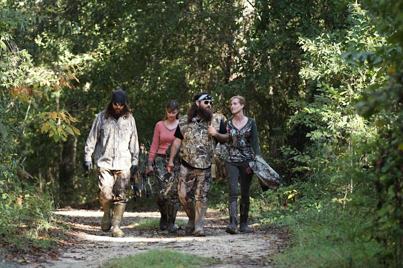 "This 2013 photo released by A&E Network shows, from left, Jase Robertson, Missy Robertson, Willie Robertson and Korie Robertson, in the episode ""Let's Go Hunting, Deer,"" from the A&E Networks show, ""Duck Dynasty."" The series star Willie Robertson will talk about his outspoken father, Phil Robertson, as he helps Fox News Channel ring in the new year. The network says Robertson and wife, Korie, will be guests on the ""All-American New Year"" special Fox News is airing Tuesday night, Dec. 31, 2013. (AP Photo/A&E Network, Art Streiber)"