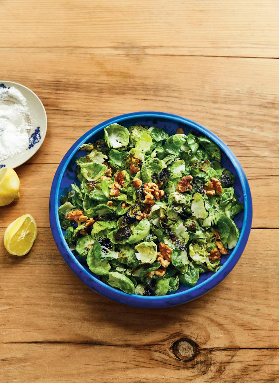 """Separating the leaves of each tiny cabbage may sound tedious, but you'll be crowned a true hero once your crowd gets a taste of the sweetest, tender-crisp brussels sprouts they've ever had. <a href=""""https://www.bonappetit.com/recipe/stir-fried-brussels-sprouts?mbid=synd_yahoo_rss"""" rel=""""nofollow noopener"""" target=""""_blank"""" data-ylk=""""slk:See recipe."""" class=""""link rapid-noclick-resp"""">See recipe.</a>"""