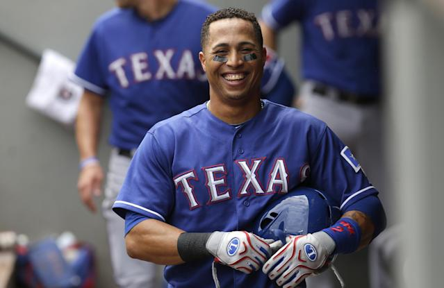Texas Rangers' Leonys Martin smiles in the dugout after he hit a three-run home run against the Seattle Mariners in the second inning of a baseball game, Wednesday, Aug. 28, 2013, in Seattle. (AP Photo/Ted S. Warren)