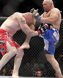 Shane Carwin (right) couldn't keep up with Brock Lesnar in Round 2