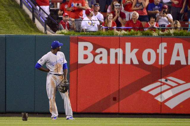 <p>Kansas City Royals center fielder Lorenzo Cain (6) looks on as a cat runs past him during the sixth inning against the St. Louis Cardinals at Busch Stadium. Mandatory Credit: Jeff Curry-USA TODAY Sports </p>