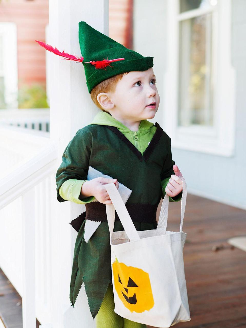"""<p>Even if you're not handy with a needle and thread, a large green t-shirt can be cleverly trimmed into a <em>Peter Pan</em>-like tunic. Fashion a hat from felt (<a href=""""https://tikkido.com/blog/DIY-peter-pan-robin-hood-hat-tutorial"""" rel=""""nofollow noopener"""" target=""""_blank"""" data-ylk=""""slk:here's a helpful tutorial"""" class=""""link rapid-noclick-resp"""">here's a helpful tutorial</a>), and you're done! Bonus: This same costume works for Robin Hood. </p>"""
