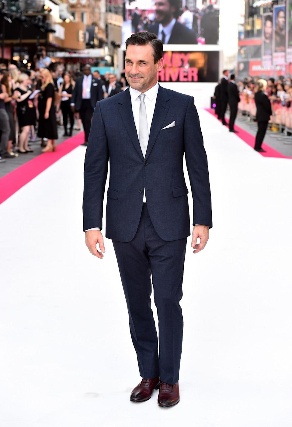<p>The 'Mad Men' rocked up to the premiere of his new film with his trademark, slicked-back locks and a spotless suit. <br><em>[Photo: PA]</em> </p>