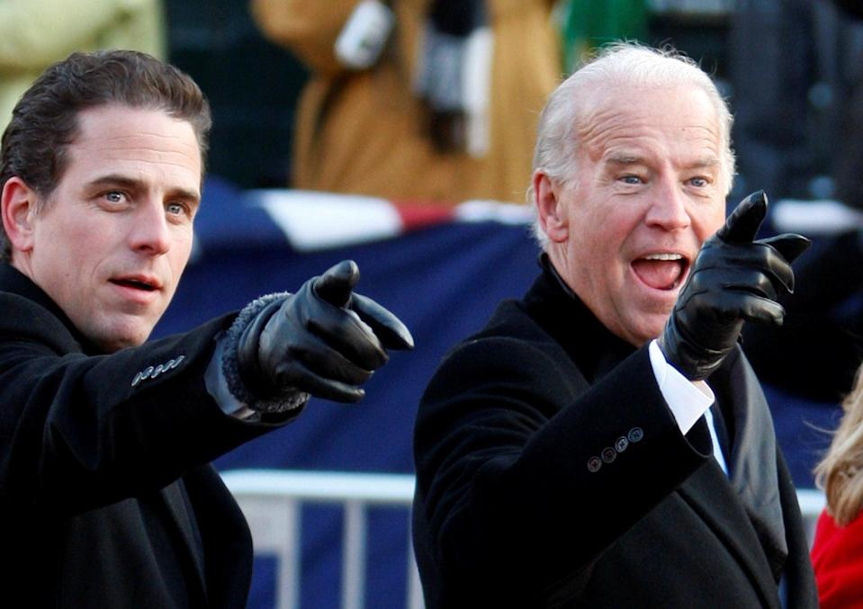 <p>With his father at Barack Obama's inauguration in 2009</p> (Reuters)