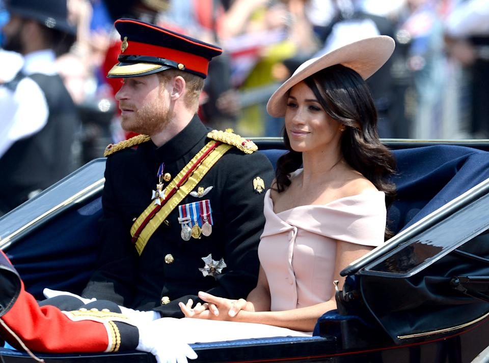The Duke and Duchess of Sussex during the carriage procession along The Mall at Trooping The Colour, London. Photo credit should read: Doug Peters/EMPICS