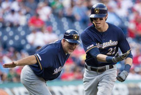May 16, 2019; Philadelphia, PA, USA; Milwaukee Brewers right fielder Christian Yelich (22) celebrates with third base coach Ed Sedar (left) after hitting a home run during the eighth inning against the Philadelphia Phillies at Citizens Bank Park. Bill Streicher-USA TODAY Sports