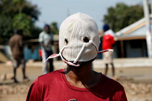 "<p>A demonstrator supporting opposition leader Raila Odinga wears a mask as he protests, after Odinga claimed ""massive"" fraud in this week's elections, in Kisumu, Kenya , Aug. 9, 2017. (Photo: Baz Ratner/Reuters) </p>"