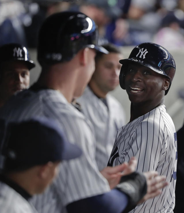 New York Yankees' Didi Gregorius, right, looks back to Aaron Judge, left, in the dugout after hitting a two-run home run against the Minnesota Twins during the fifth inning of a baseball game Tuesday, April 24, 2018, in New York. (AP Photo/Julie Jacobson)