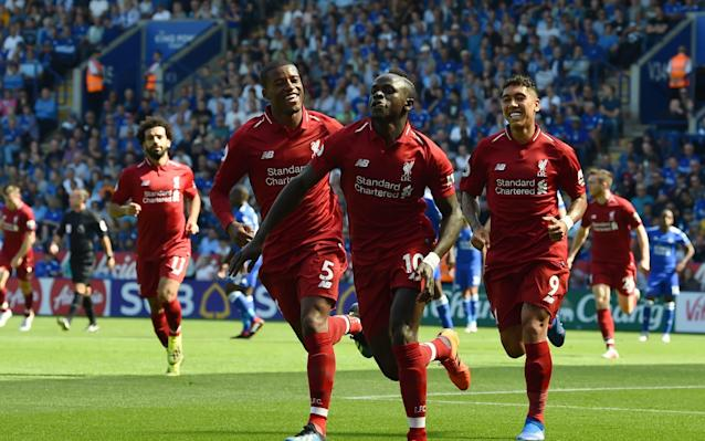 Liverpool players celebrate going in front early at Leicester on Saturday