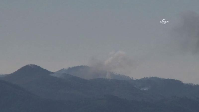 Smoke billows from the spot where the Su-24 warplane crashed in Hatay (AFP Photo/)