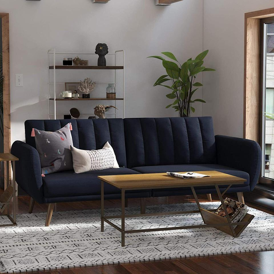 """Noone will realize it's a futon, unlike that metal monster you've been using as extra seating in the TV room. Blech.<br /><br /><strong><a href=""""https://www.amazon.com/Novogratz-Brittany-Sofa-Futon-Linen/dp/B01LY1WBQN?&linkCode=ll1&tag=huffpost-bfsyndication-20&linkId=2a28335dac288d74fe5dcae3e5f3adff&language=en_US&ref_=as_li_ss_tl"""" target=""""_blank"""" rel=""""noopener noreferrer"""">Get it from Novogratz on Amazon for $295.99+ (available in several colors and styles, including sleeper couches).</a></strong>"""