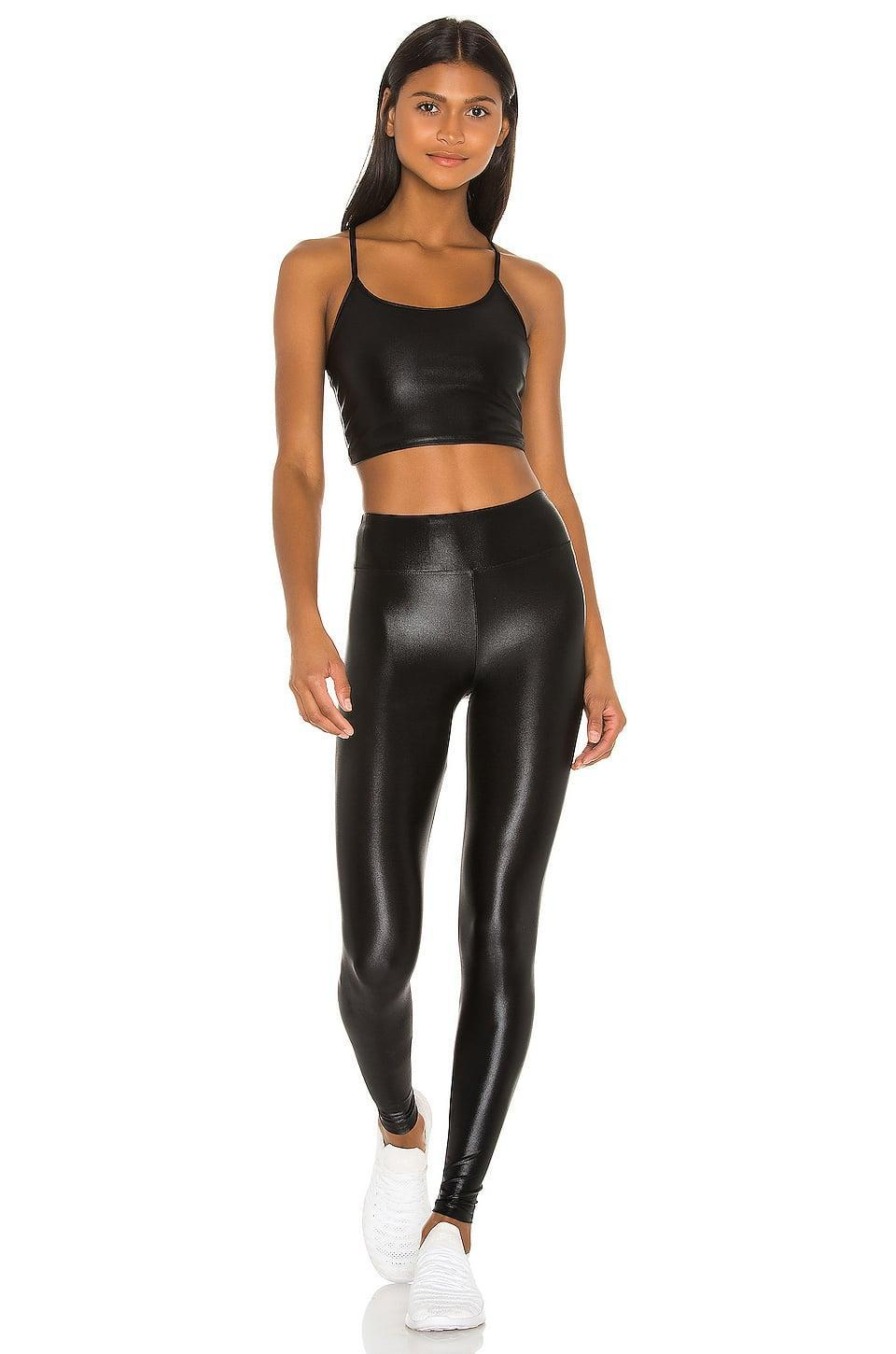 <p>This shiny <span>Koral Leah Infinity Sports Bra</span> ($65) and <span>Lustrous High Rise Legging</span> ($80) looks so good on. If you're working up a sweat, like in a hot yoga or boxing class, grab this set.</p>