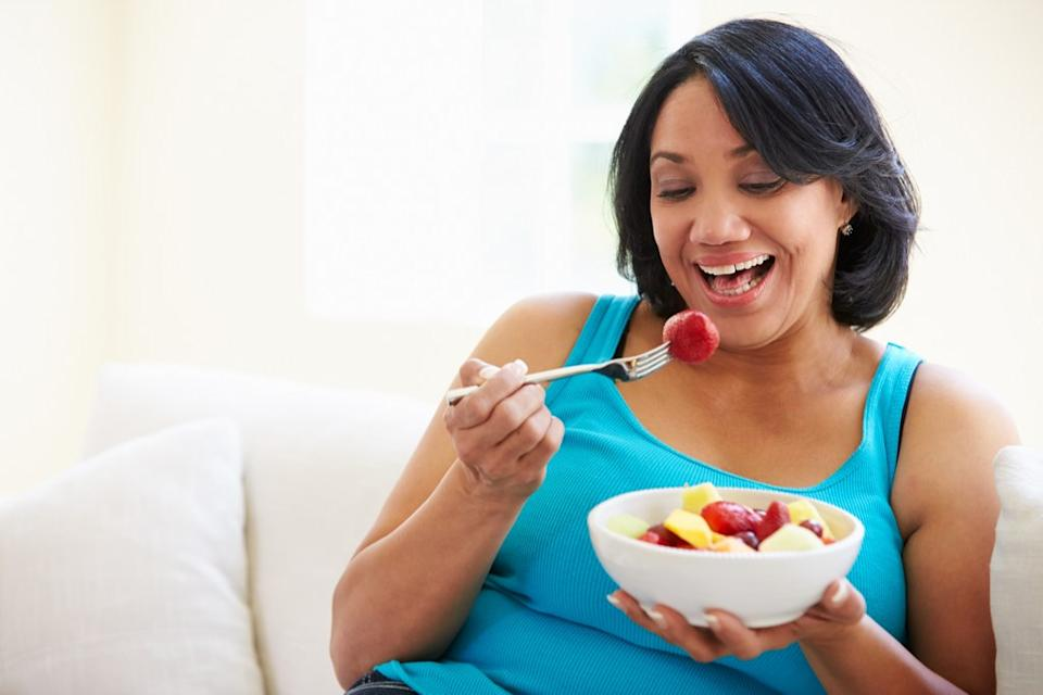 Older Woman Eating Fruit, look better after 40
