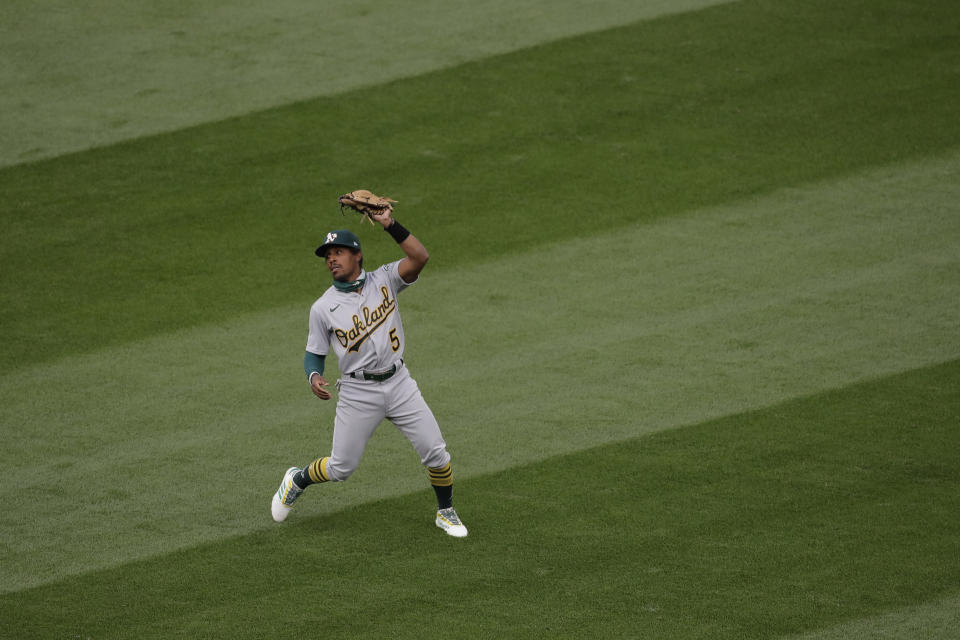 Oakland Athletics second baseman Tony Kemp makes a catch during the first inning of a baseball game against the Seattle Mariners, Friday, July 31, 2020, in Seattle. (AP Photo/Ted S. Warren)