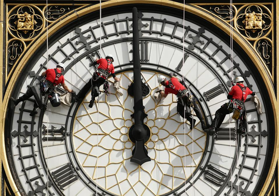 REVIEW OF THE DECADE File photo dated 18/8/2014 of a specialist technical abseil team clean and inspect one of the four faces of the Great Clock, otherwise known as Big Ben, at the Houses of Parliament, in central London, as they undertake essential maintenance and cleaning of the four faces.