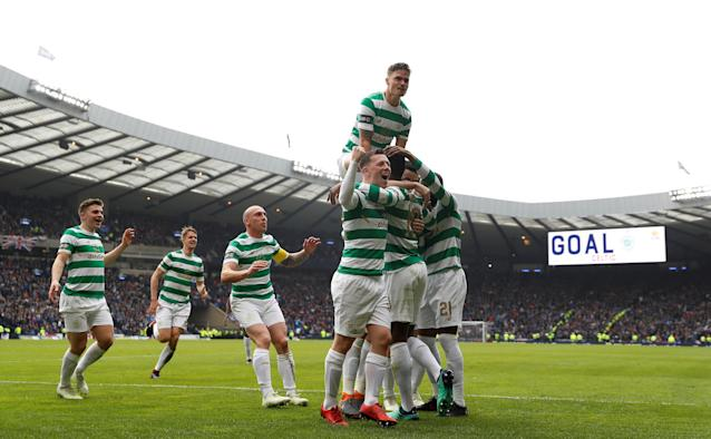 Soccer Football - Scottish Cup Semi Final - Celtic vs Rangers - Hampden Park, Glasgow, Britain - April 15, 2018 Celtic's Moussa Dembele celebrates scoring their third goal with teammates Action Images via Reuters/Lee Smith