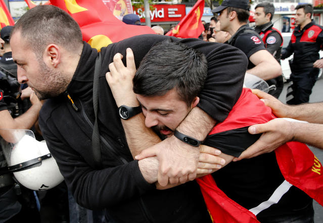 <p>Police detain a demonstrator during May Day protests in Istanbul, Turkey, May 1, 2018. Workers and activists mark May Day with defiant rallies and marches for better pay and working conditions. (Photo: Lefteris Pitarakis/AP) </p>